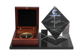 Actual compass mounted on a black plexi base, clear cut-top crystal block at right