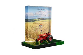 Die-cast tractor in front of a wheat field backdrop