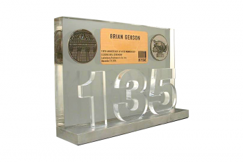 "Clear cut plexiglass ""135"" in front of a clear Lucite panel with coin & card embedments"