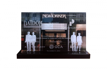 Storefront printed on back of a crystal panel with customer silhouettes 2D etched at right & left