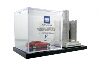 Hot Wheels minature in a custom plexi box beside a custom pewter model of Detroit's Renaissance Center.